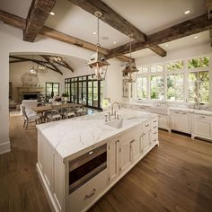 beams and openess. large island. mix of white walls and barn wood.