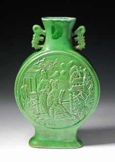 A Chinese Qing Dynasty Green Glazed Porcelain Moon Flask: finely molded on both sides with the design of young couples reading in pavilion, applied overall with apple green glaze, with two handles around shoulders, the six character 'Qianlong' inscribed in one line on the base; Size: H: 15""