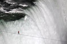 Tightrope walker over falls