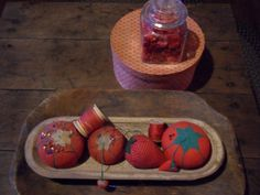 Love those old tomato pin cushions with the baby strawberry attached.