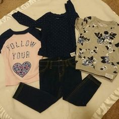 3tops and leggings 2 long sleeve Carters tees 12 months- 1 cotton navy with gold stars- 1 cotton pink with navy sleeves floral wording, follow your heart|| denim jeggings in sz 12-18months circo|| short sleeve sweater with navy and white flowers by Carters as 12 months EUC jeans never worn but washed these fit like 12 months which is why I'm including them with shirts carters Tops