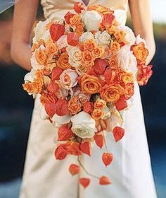 Orange roses, peach roses, cream roses, with real preserved chinese lanterns.