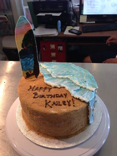 beach birthday cake. edible sand and buttercream waves with a hand painted sugar surf board  White Rock BC Nut-free Bakery