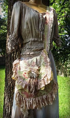 Shabby clothes- Shabby chic fashion torn curled fabric strings act like dying petals on a flower, mottled base fabric acts like a natural background allowing the overlaying lace trims and flowers to pop forward.