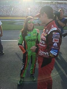 Danica Patrick and Jeff Gordon talk on the grid prior to qualifying for the 2015 Coca-Cola 600, 5/21/15.