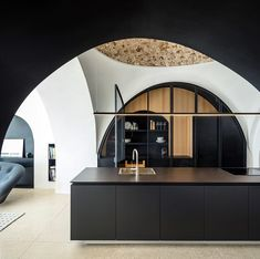 @pitsou_kedem_architect has refurbished a historic apartment in Jaffa. A modern cave, where the living accommodation oriented towards the sea remains visible throughout the scheme | Photo © @amitgeronphotographer