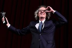 Geoffrey Rush Photos Photos - Australian actor Geoffrey Rush receives the Berlinale Camera award at the 67th Berlinale film festival in Berlin on February 11, 2017. / AFP / Tobias SCHWARZ - Geoffrey Rush Receives the Camera Award at the 67th Berlinale Film Festival
