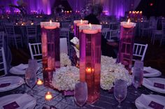 centerpieces: easy to do / tall square vase with rhinestone and floating candle inside purplish water