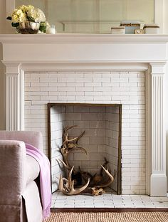 love the tile and antlers in the fireplace.