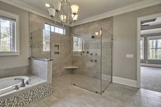 Transitional Master Bathroom with Pendant light, slate tile floors, Crown molding, frameless showerdoor, High ceiling