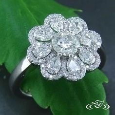 This platinum diamond Daisy is the perfect #SpringWedding #engagementring! #Ido love #GreenLakeMade