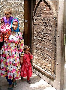 A young Coptic Christian mother and children leaving church.  Cairo, Egypt.