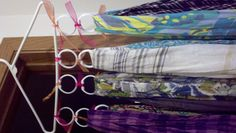 old shower curtain loops attached to a hanger for organizing scarves or ties, great space saver!