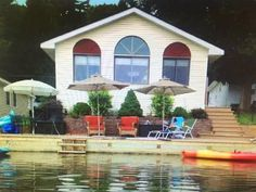 YorkTeam open house Sat 6/9 from 12-2pm. Adorable lakeside year round home located on Lake Sunnyside. Completely remodeled and in great condition with circle top windows overlooking the water with perfect southwest exposure for long afternoons at the waters edge. Sunnyside is non-powerboat and no annoying jet skis buzzing all day just peaceful fishing swimming kayaking canoeing and small electric motor boats. Ready for year round delights. Property includes separate parcel with two car…