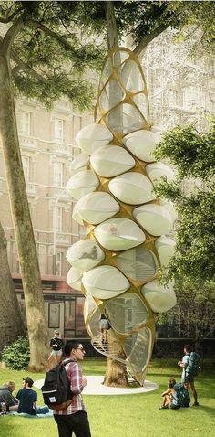 """Chamada de """"Tree Hopper"""", o projeto vencedor apresenta estrutura mista - construída em torno de uma árvore. Por meio de uma escada helicoidal, o visitante poderá acessar confortáveis alojamentos, que se parecem com casulos de abelhas.#arquitetura #casanaárvore #natureza"""