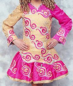 Very bright and beautiful pink, gold & white dress. Covered with clear, pink and gold crystals. Worn by PC-Champ dancer, 1 owner. There is room for let out in this dress, if needed. I am h...