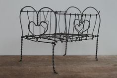 Antique wire doll bed