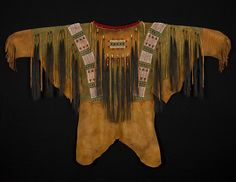 This shirt was inspired by an 1870's Lakota Sioux shirt in the National Museum of the American Indian. The red stripes on the lower arms of the shirt represent coup marks, which could be earned for va