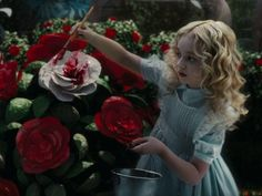 Alice in Wonderland Tim Burton Young Alice Paint Roses Red