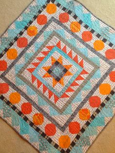 dream quilt create: Mini Medallion - finished! I love the color combination she chose.