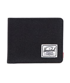 A sleek black canvas exterior provides durable style with plenty of card slots for all your cards and a Herschel Supply logo patch.