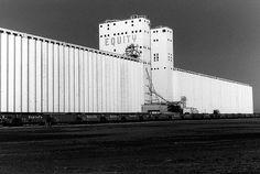 One of several grain elevators near Enid Oklahoma. Photo by Blake Gumprecht, via Flickr
