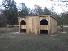 I built this 2 stall horse barn from 2 big 7'x14' and 2 10' x 14' industrial pallets that I got from a friend who gets them from a factory that build generators here in south Georgia