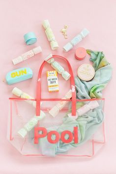 Destination bachelorette party favor idea - clear tote bag with sunglasses, scarf, bottle opener, sweet treats and more {Courtesy of Sugar & Cloth}