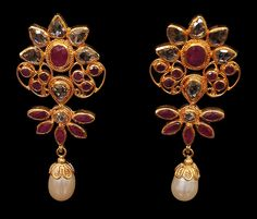 Uncut diamond, ruby and pearl eardrops. A clear cut, vivid floral design is the feature of this eardrops. Set in      22 carat gold in twist design, it is subtle in colour and easy on the eye. The fine mix of uncut diamonds, rubies and pearl drops liberally spaced apart give it a carefree look. Very attractive and a wonderful piece for a light-hearted occasion.
