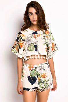 the matching sets featuring a cape crop top,floral print and a high waist shorts. wear it with sandals for an elegant summer look.