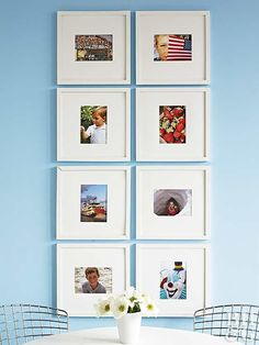 Go all out to fill up boring walls. Hang a grid of favorite pictures or prints inside frames with large mats. The bigger mats will provide much-needed white space for an active display. Onlookers will be able to take in each photo, which makes for an effective display.