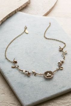 """A sweet little ode to springtime, our Nest Necklace has little pearl   """"eggs."""" Delicate & sweet!"""