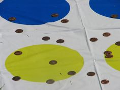 Penny Toss. Had to stand behind a line and toss pennies onto a Twister mat trying to get them to land on the colored circles.