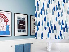 composite of two photos, one of three pieces of framed art against a blue wall over white wainscotting and the other of a bold, blue and white teardrop-patterned shower curtain hung over a clawfoot tub