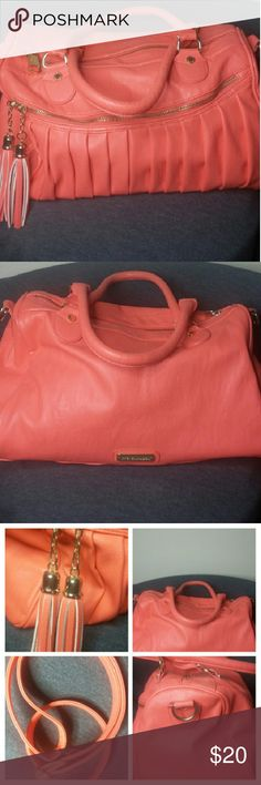 STEVE MADDEN LARGE SATCHEL Coral with gold details. Features two tassel zipper details. Pleated front plain back with Steve Madden logo. Large front zipper, (1) inside zipper with cell phone holder pockets. Gently used, No trades. Bags Satchels