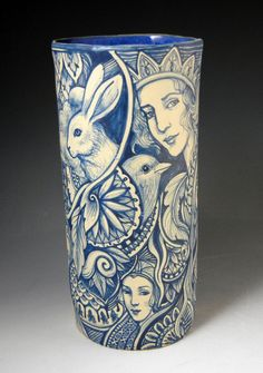 Blue and white hand painted stoneware story vase with castle, faces, rabbit, bird, peace and more