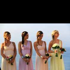 Pastel bridesmaid dresses - maybe altered to be shorter. I like the style though.
