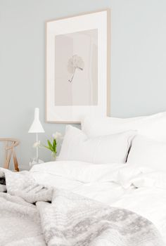 Pale blue bedroom with an all-white interior