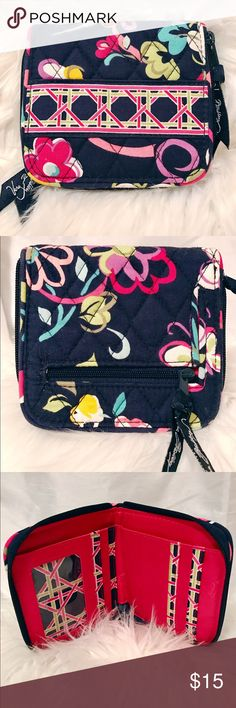 Small Vera Bradley zip around wallet Lovely Vera Bradley -small zip wallet- featuring 'Ribbons' pattern. Perfect for use in a small purse or cross body. Used very briefly, like new! Ideal size for a small summer bag! Contains bill slot and several card slots on the inside. Outside features a small change compartment. Both zippers have Vera Bradley ribbons. iPhone 6 pictured for size examination.👛☀️ Vera Bradley Bags Wallets