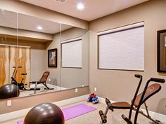 Yoga and Fitness Room: Just like at the gym or yoga studio, a mirrored wall adds function and the illusion of more space in this small at-home fitness room. The carpeted floor reduces noise and provides a soft surface for bare feet. From HGTVRemodels.com