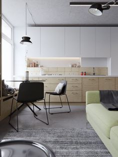 This 40sqm, two-level studio apartment plays with a cool background palette…