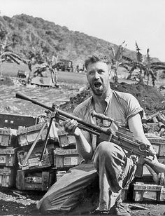 A Marine on Saipan with a Nambu type 99 gun - a light machine gun used by the Imperial Japanese Army in World War II.