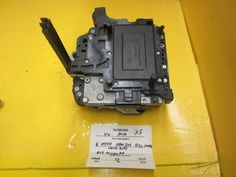 Please check the part number and match the picture . This Transmission Valve Body is for 2003 ~ 2009 .This part is for  front of your vehicle.Please compare the part number(s):  02E 927770 AE, 02E927770AE make sure to check with your local dealer before purchasing it.