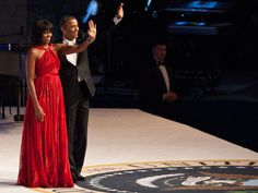Inauguration Day 2013: First lady Michelle Obama's fashion choices - CBS News.  President Barack Obama and first lady Michelle Obama attend the Commander-in-Chief's Ball, honoring US service members and their families.  Mrs. Obama wore custom-made Jason Wu gown. The ruby-colored dress was a follow-up to the white gown Wu made for her four years ago.