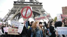 Hundreds of protesters took to the streets of the French capital in a show of defiance on Saturday amid anxiety over what Donald Trump's election to the White House will entail for immigrants, minority groups and women.