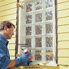 Installing a premade glass block window in a bathroom.