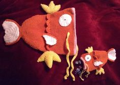 capitaine-crochet:A dear friend wanted a Magikarp hat, so I made him one plus a dice bag complete with good dice to replace the ones that he kept getting critical fails with.