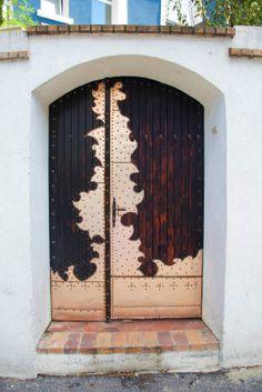Stylish wood door with metal overlay. Paris