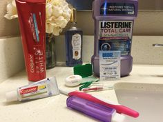 adult braces update with products used to help keep braces clean at home - toothpaste, mouthwash, floss on bathroom counter