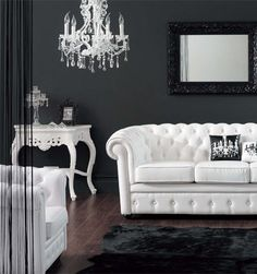The black walls and rug make a real statement of the white furnishings.
